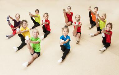 Happy active children in gym