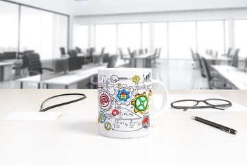 Cup with business scheme print and badge on the table in open sp