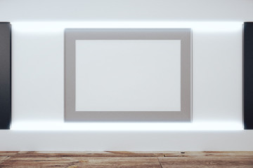 Blank grey picture frame on white wall in empty room with wooden