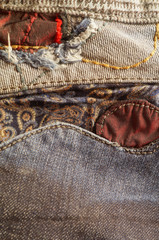 Jeans pocket with insert of fabric, patterns red thread