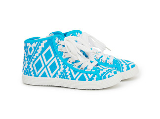 Sports sneakers in blue thick fabric. Presented on a white backg