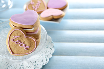 Pile of love cookies on blue wooden table background