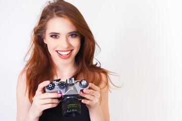 cute girl make a foto selfie at vintage camera.