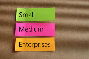 Small Medium-sized Enterprises (SME) text on colorful sticky not