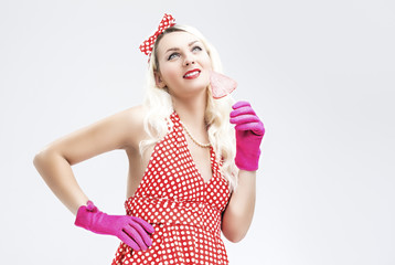 Pinup Retro Concepts. Dreaming Sensual Pinup Blond Woman With Sweet Candy