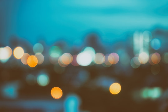 abstract background with bokeh defocused lights and shadow from cityscape at night, vintage or retro color tone