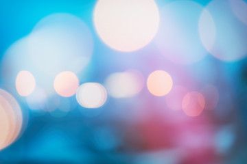 abstract background with bokeh defocused lights and shadow from christmas night party, vintage or retro color tone