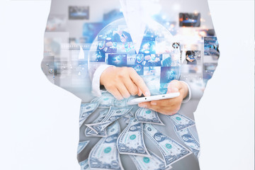 Businessman using digital tablet.double exposure of businessman.