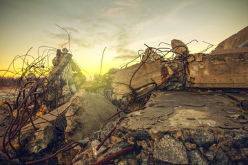 Old ruins of a building.The debris of the damaged building on sunset sky background Wall mural