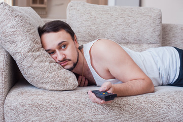 man with the beard carries out weekend on couch