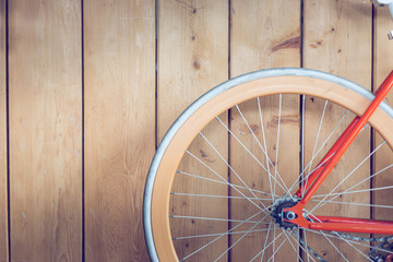 bicycle parked with wood wall, close up image part of bicycle