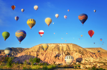 Colorful hot air balloon flying  in  blue sky  at Cappadocia ,Turkey