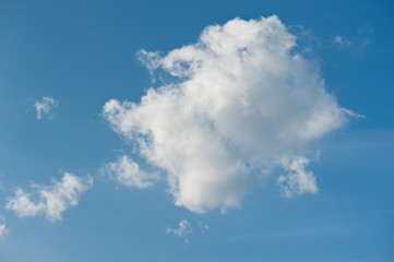 One large white cloud in blue sky