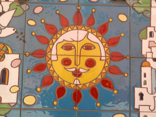 Smiling sun on wall
