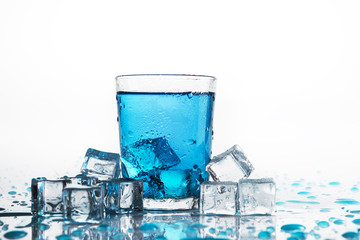 Water glass and cold ice cubes