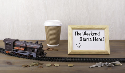 Train on railway, coffecup, money, keys and frame with text - Th