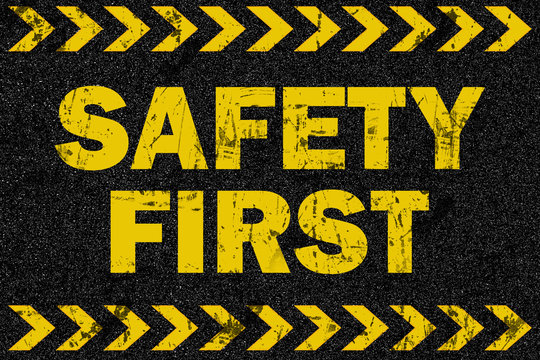 Safety first word on grunge background