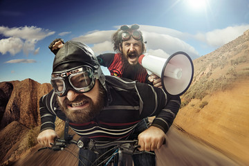 Funny portrait of a tandem of cyclists Wall mural