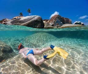 Wall Mural - Woman snorkeling at tropical water