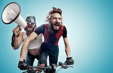 Aluminium Prints Artist KB Two hilarious cyclists involved in a contest