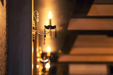 beautiful gold lamp on a wall