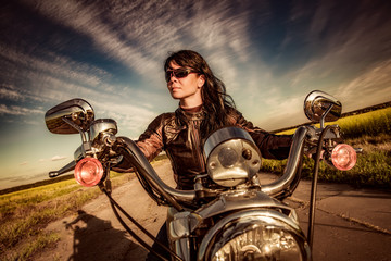 Leinwandbilder - Biker girl on a motorcycle