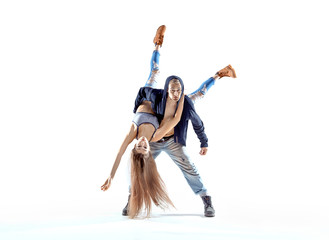 Strong hip-hop guy carrying his dance partner