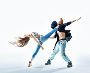 Two athletic dancers making a performance