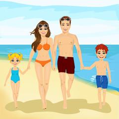 happy family walking along a beach