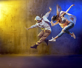 Spoed Foto op Canvas Dance School Stylish dancers fancing in a concrete area