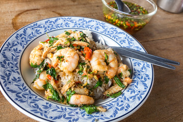 Closeup of Thai's local dish, shrimp stir fried with basil, and fish sauce