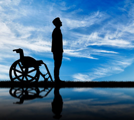 Silhouette of disabled and wheelchair