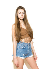 Portrait of modern young woman in boho summer outfit