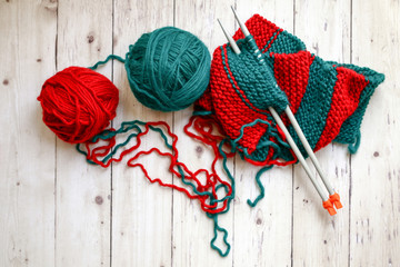 Yarn with knitting needles, top view
