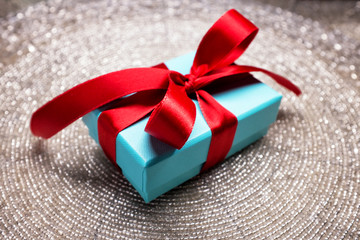 Gift in a beautiful box with a bow, candy