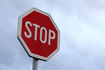 Stop sign on cloudy sky