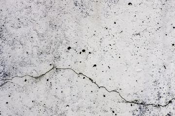 Texture di sfondo di un  muro, in cemento, con crepa che scorre orizzontalmente