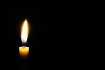 White candle light with black background
