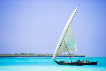 Old wooden dhow in the Indian Ocean near Zanzibar