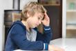 Kind bei den Hausaufgaben