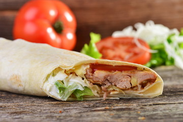 chicken wrap in tortilla with sauce