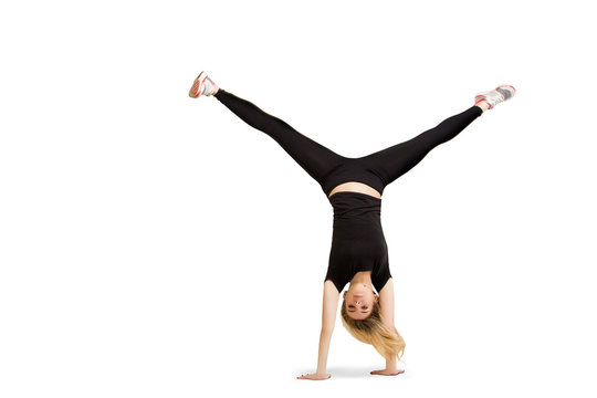 Caucasian woman doing cartwheel isolated on white