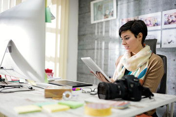 Business woman designs photos on computer