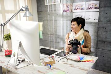 Employed woman working in photo studio.