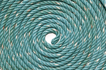Circle Roll texture of old green nylon rope.
