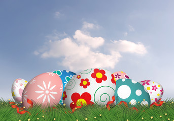 color easter eggs on grass. beautiful sky background with copy space