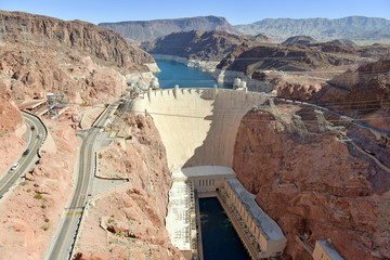 Hoover Dam, a massive hydroelectric engineering landmark located on the Nevada and Arizona border built to harness power from the Colorado River, is a top tourist attraction from Las Vegas