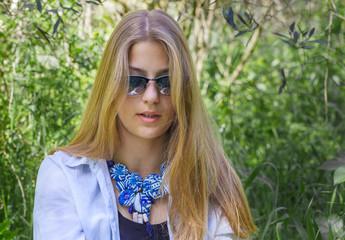 Beautiful boho style girl on green nature background