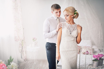 Newlyweds in a bright vintage interior