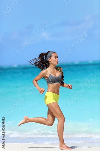 Full Length Body Of Woman Jogging Fast Barefoot On Sand Training Doing Her Cardio Workout During Summer Vacation Living A Healthy Lifestyle